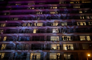 Guests at the Pullman hotel hold a silent balcony party in Paris, France. New Year's eve celebrations and fireworks were cancelled throughout France