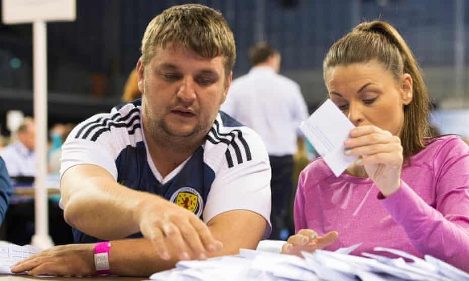 Counters sort EU referendum votes at Glasgow's Emirates Arena