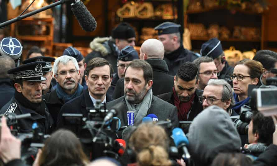 Christophe Castaner talks to the press during the reopening of the market