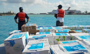 Crew members from Royal Caribbean Cruise Line's Symphony of the Seas, the world largest cruise ship, load humanitarian aid for residents of Grand Bahama top be delivered from Nassau.
