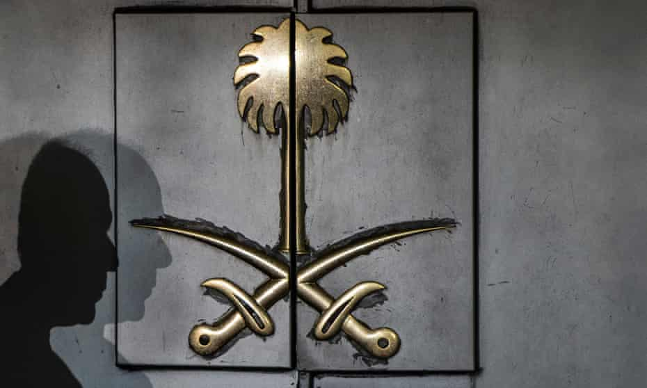 The shadow of a security guard is seen on the entrance door of the Saudi consulate in Istanbul.