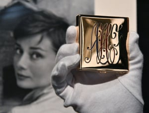 A monogrammed powder compact from the 1950s, expected to fetch £2,000 to £3,000.