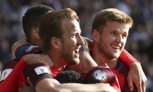 England's Harry Kane is surrounded by team-mates after scoring his side's stoppage-time goal