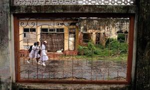 children make their way past a derelict building in Jaffna, Sri Lanka, during the civil war.