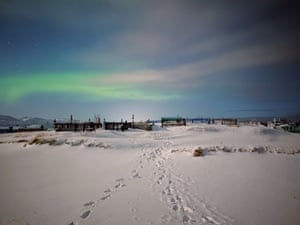 The northern lights glow above a cemetery in the coastal village of Teriberka