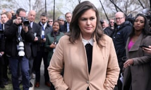 Sarah Sanders departs after speaking to reporters at the White House in Washington DC, on 2 April.