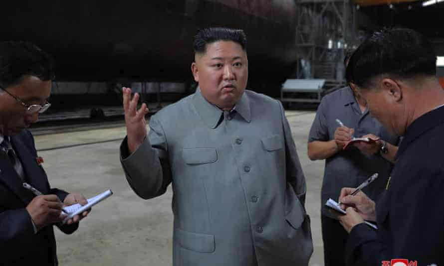 Kim's inspection of the craft is an 'ominous signal' about North Korea's military ambitions, say analysts.