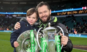 Ireland's defence coach, Andy Farrell, celebrates winning the Six Nations grand slam with his son, Gabriel.