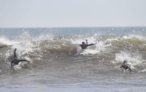 Surfers in Boscombe, Dorset