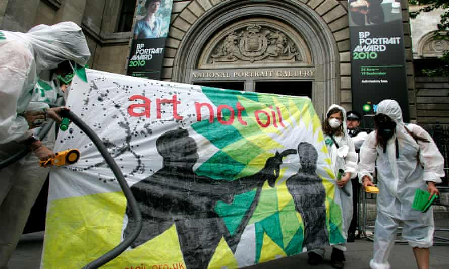 Campaigners dressed as a mock clean-up crew called the 'Greenwash Guerrillas' hold a banner outside the National Portrait Gallery in London, Tuesday, June 22, 2010, where the BP Portrait Award ceremony is held. Campaigners claim that the National Portrait Gallery's sponsorship deal with BP helps the oil giant to 'greenwash' its tattered public image, and want the gallery to terminate BP's contract. (AP Photo/Akira Suemori)