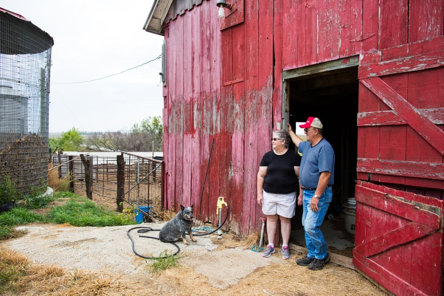 Joyce and John Blaske stand at the entrance to their barn at their farm in Onaga, Kansas.