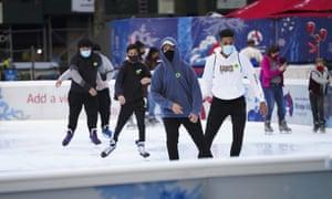 People skate in the ice rink at Bryant Park in New York, 6 November 2020.