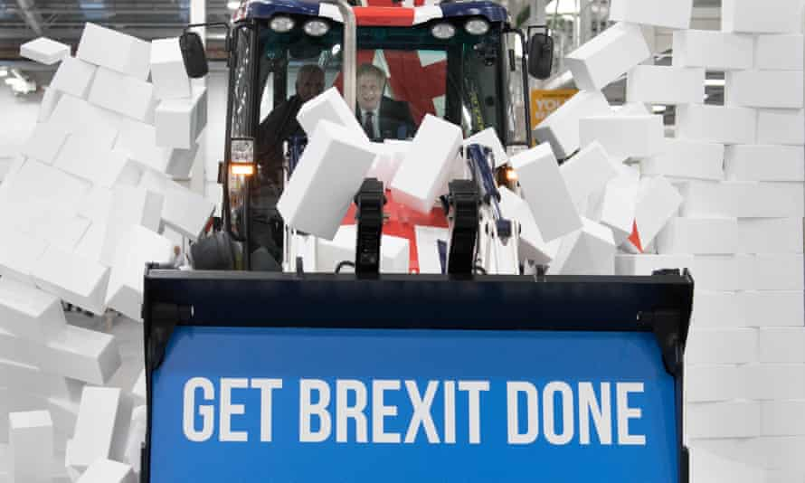 Boris Johnson drives a JCB through a fake wall during the election campaign. JCB-linked companies gave his party more than £3.2m.