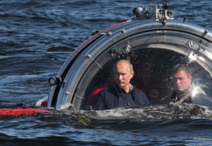 July 2013: Putin rides in a submersible in the Baltic Sea near Gotland Island. The vessel dove to the sea floor to explore a sunken ship in the Gulf of Finland