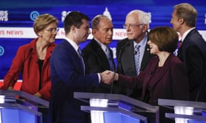 Democratic presidential candidates greet one another on stage at the end of the Democratic presidential primary debate in Charleston.