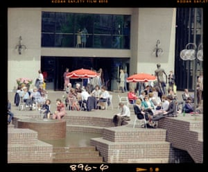 Visitors relax in the sun on the Lakeside Terrace, then the main entrance to the Centre (Apr 1982)