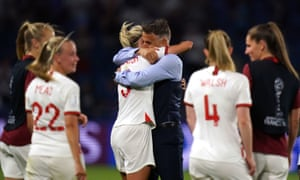 Phil Neville hugs England captain Steph Houghton after the 3-0 win over Norway.