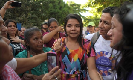 Imelda Cortez, centre, is accompanied by relatives after she was acquitted and released, outside the judicial centre for sentencing in Usulután, El Salvador.