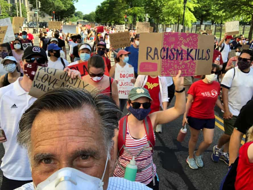 Mitt Romney marches during a protest against racial inequality in Washington on Sunday.