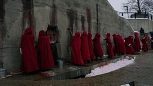 Preparing for visitors … the women scrub the blood off the walls where bodies usually hang.