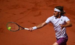 Stefanos Tsitsipas returns the ball to Novak Djokovic.