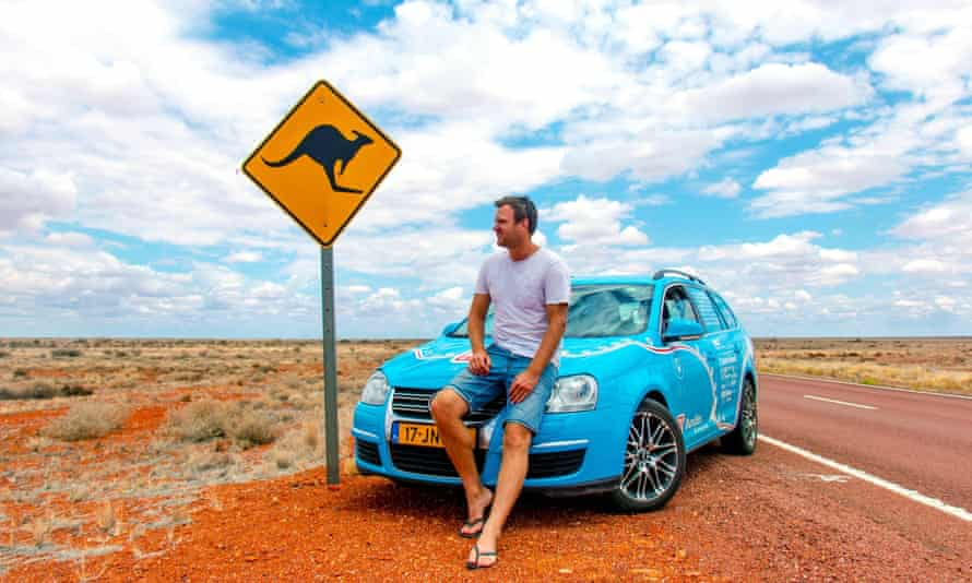 Wiebe Wakker with the electric car he made a round-the-world trip in. Electric vehicles have become a point of difference between the Coalition and Labor in the Australian election.