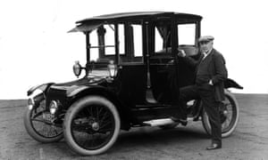Thomas Alva Edison standing beside a Detroit Electric touring automobile, produced by Detroit's Anderson Electric Car Company, 1914.