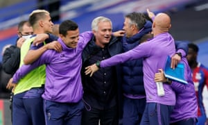 José Mourinho celebrates with his backroom staff after securing a top-six finish.