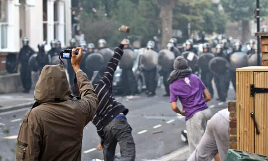 Rioters are filmed throwing missiles at police lines in London, during five nights of rioting in the capital and across the UK
