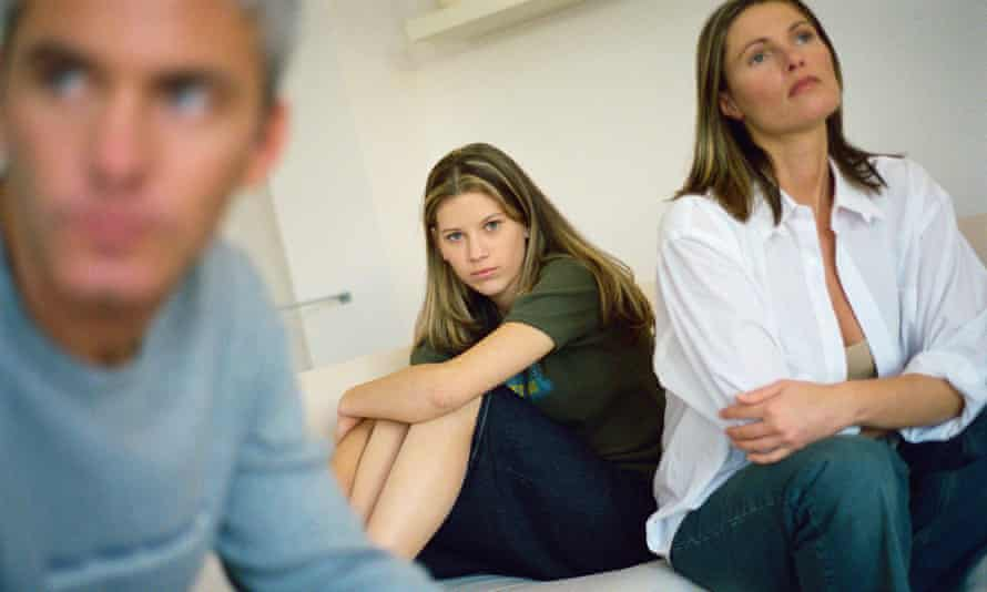 Man, woman and teenage girl all looking miserable