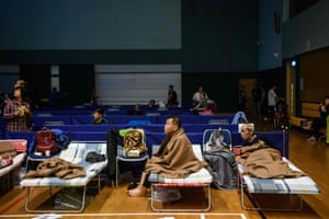 Residents rest in a shelter in the village of Lei Yue Mun, Hong Kong