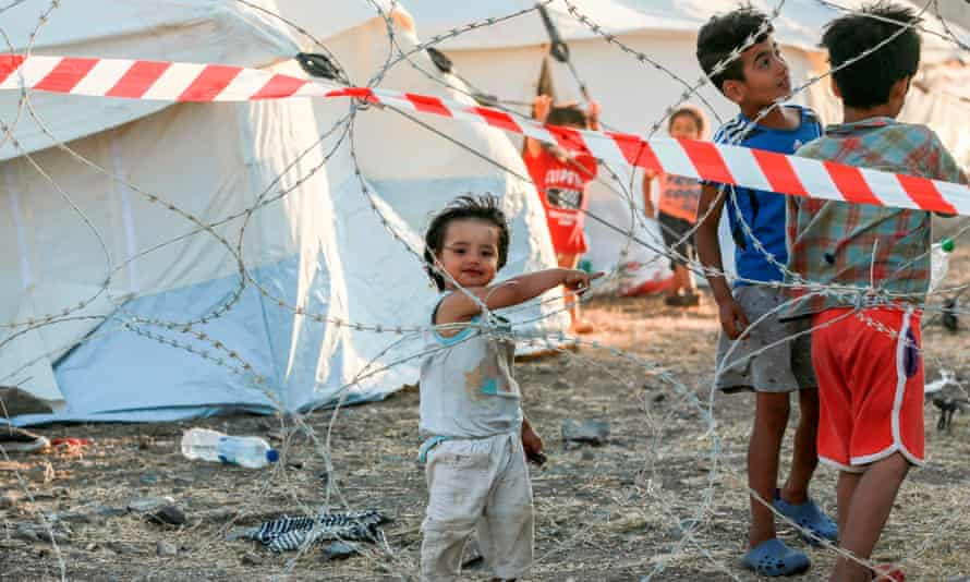 Refugee children at a Covid quarantine area in the new temporary camp on the Greek island of Lesbos. Most of the refugees on the island were left homeless after fires ripped through the camp.