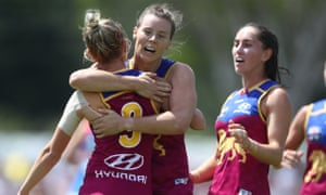 Brisbane Lions players celebrate victory in the match against the Western Bulldogs at South Pine Sports Complex on Saturday.