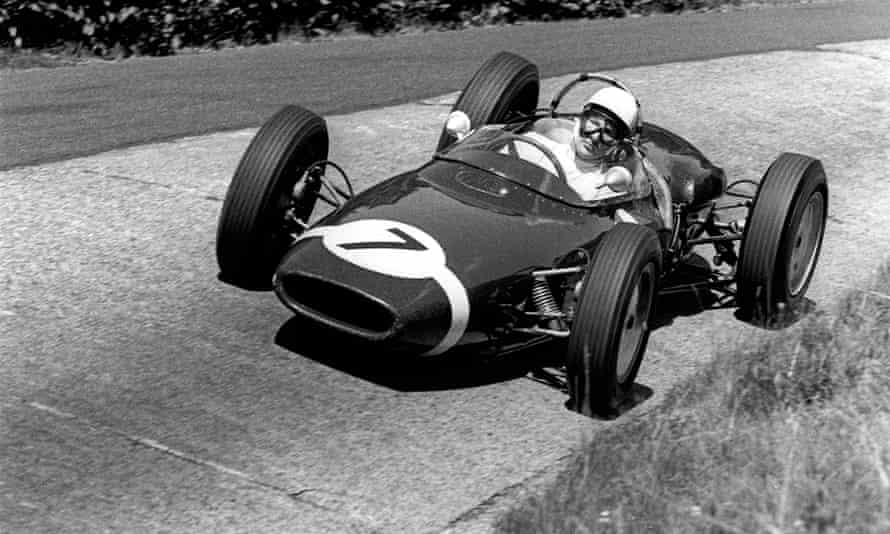 Stirling Moss driving a Lotus-Climax 18 in the German Grand Prix at the Nürburgring, 1961.