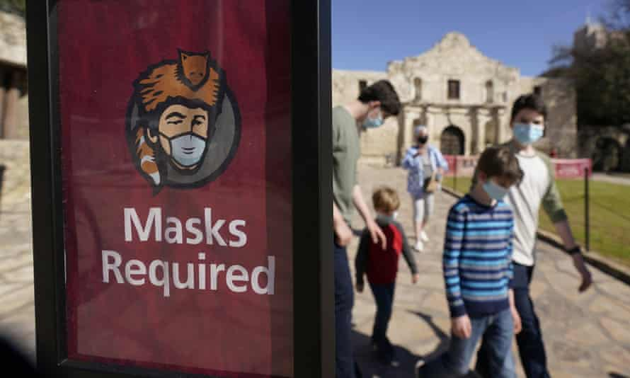 Visitors to the Alamo in San Antonio wear face masks on 3 March.