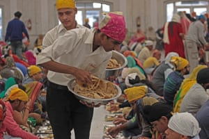 Food being served at the langar at Bangla Sahib gurdwara in New Delhi in 2018.