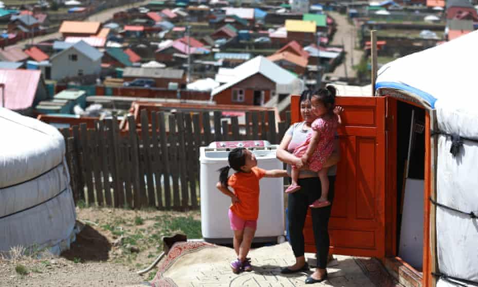 Erdenechimeg Sanlig and her grandchildren in the ger residential district in Mongolia