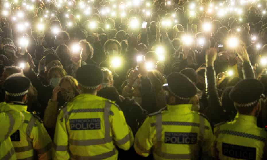 People in the crowd turning on their phone torches in Clapham Common, London, for a vigil for Sarah Everard.