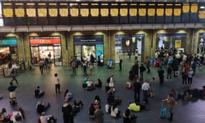 People wait at King's Cross in London as the power cut affects all services in and out of the station