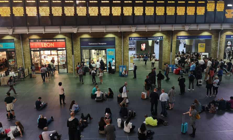 Passengers at King's Cross station during the power cut on 9 August.