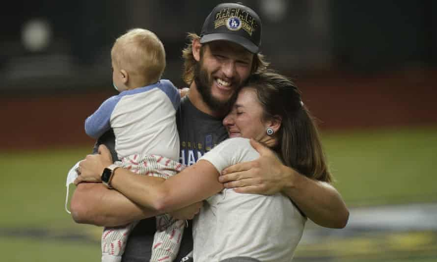 Clayton Kershaw celebrates with his family after the Dodgers clinched the World Series