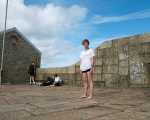 Cameron, from Penzance, wearing shorts and a T-shirt