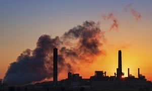 The Dave Johnson coal-fired power plant is silhouetted against the morning sun in Glenrock, Wyoming