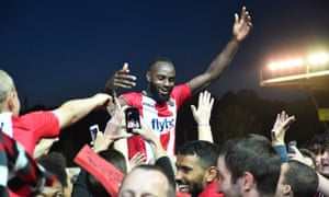 Hiram Boateng celebrates with Exeter fans after the club reached the League Two play-off final, in which they face Coventry on Monday.