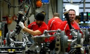 Employees of German car manufacturer Porsche working at the Porsche factory in Stuttgart-Zuffenhausen, Germany.