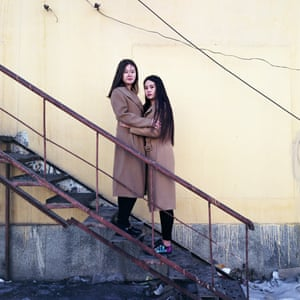 Two women in an image from Chen Ronghui's series, Freezing Land