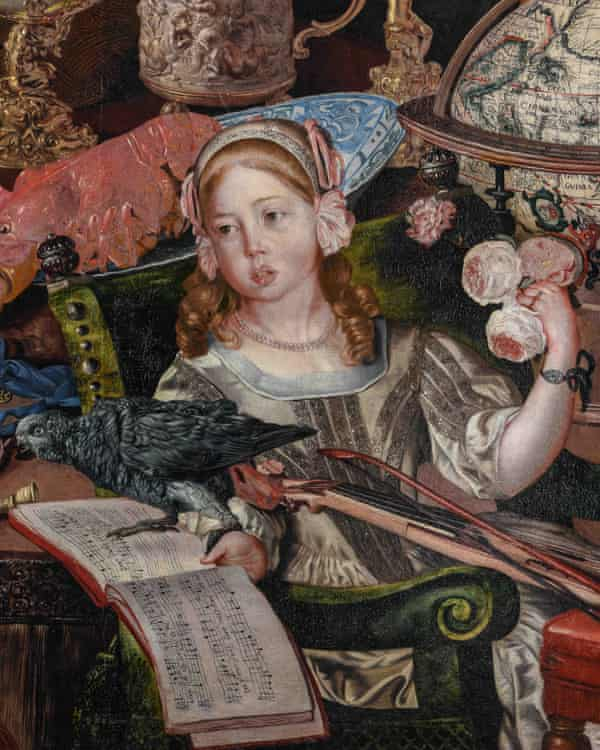 Closeup of the pale little girl holding a musical score