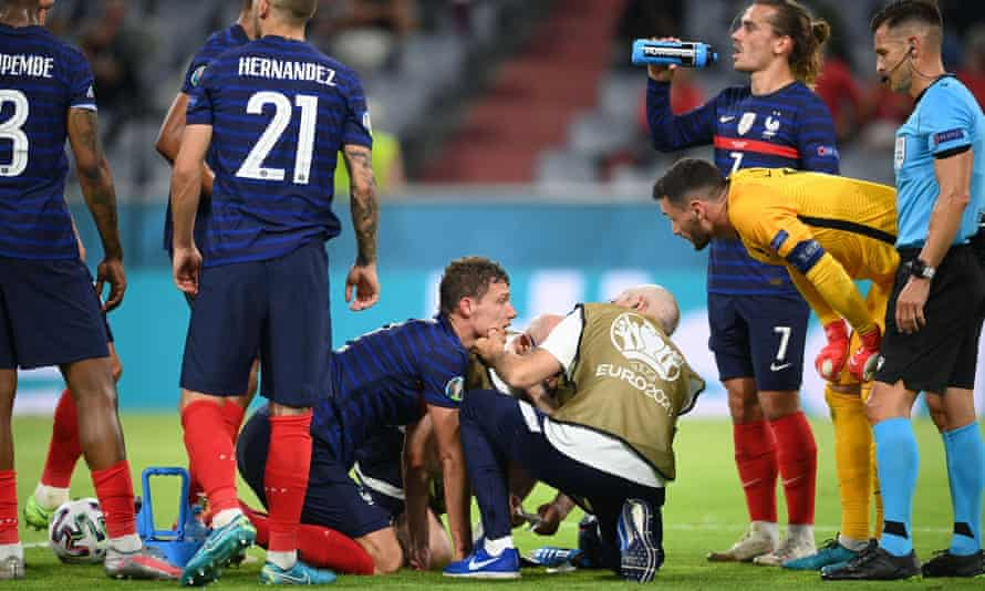 France's Benjamin Pavard receives medical attention after sustaining a head injury