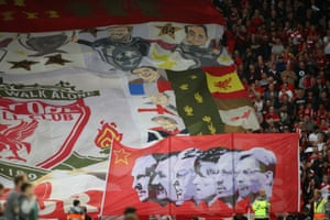 Liverpool fans display their banners before belting out the Anfield anthem.