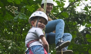 Young children climbing  tree